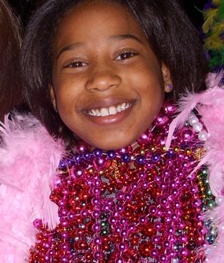Mardi gras girl with beads