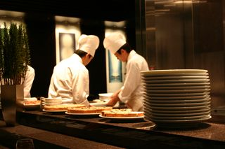Bigstockphoto_two_chefs_working_in_a_busy_re_1345006
