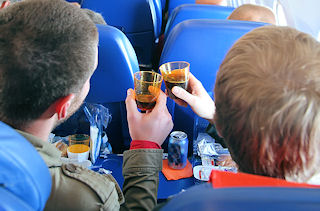 Passengers drinking In The Airplane