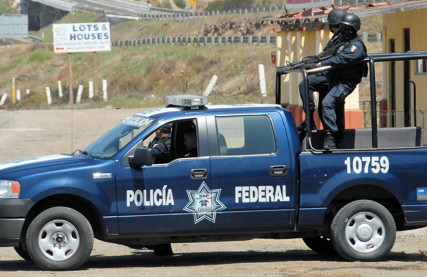 Mexican Police with automatic weapons.