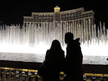 Couple watching the fountain in front of the Bellagio Hotel in Las Vegas.