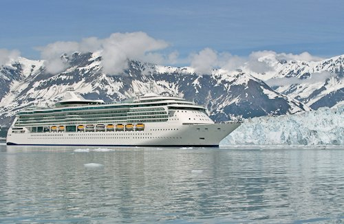 Cruise ship glides by glacier in Alaska