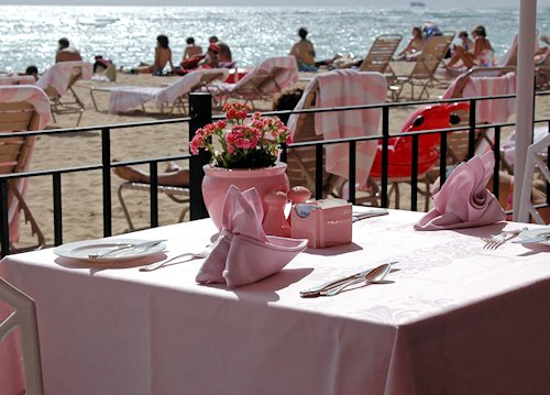 Beachfront cafe table at the Royal Hawaiian Hotel, Honolulu Hawaii.