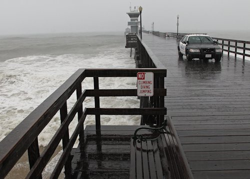 Storm heads toward Seal Beach pier.