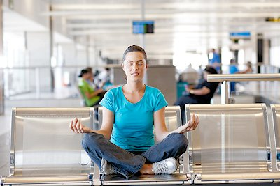 woman doing yoga at airport