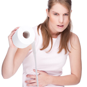 Sick Woman with Toilet Paper