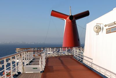 Iconic smoke stack on a Carnival Cruise ship as it leaves Long Beach CA.