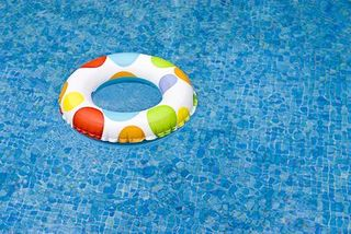 pool with toy life ring